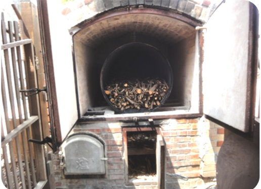 Picture 3: The third generation of biochar kiln in Dayou Village relies on hardwood as fuel to produce biochar.